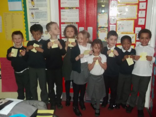 These children receive their yellow behaviour badges